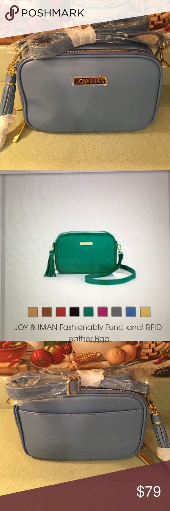 NWT JOY & IMAN LEATHER PURSE This is new with all the paper still on. It's a very pretty med blue color trimmed in gold. It is from HSN. Has 2 compartments and a pocket outside. Has a large leather tassel on side Strap can be adjusted to many lengths. Very pretty would be beautiful for spring. Can go on HSN to read more about it. It has built in RFID BLOCKING for your license and credit cards. Bags Shoulder Bags