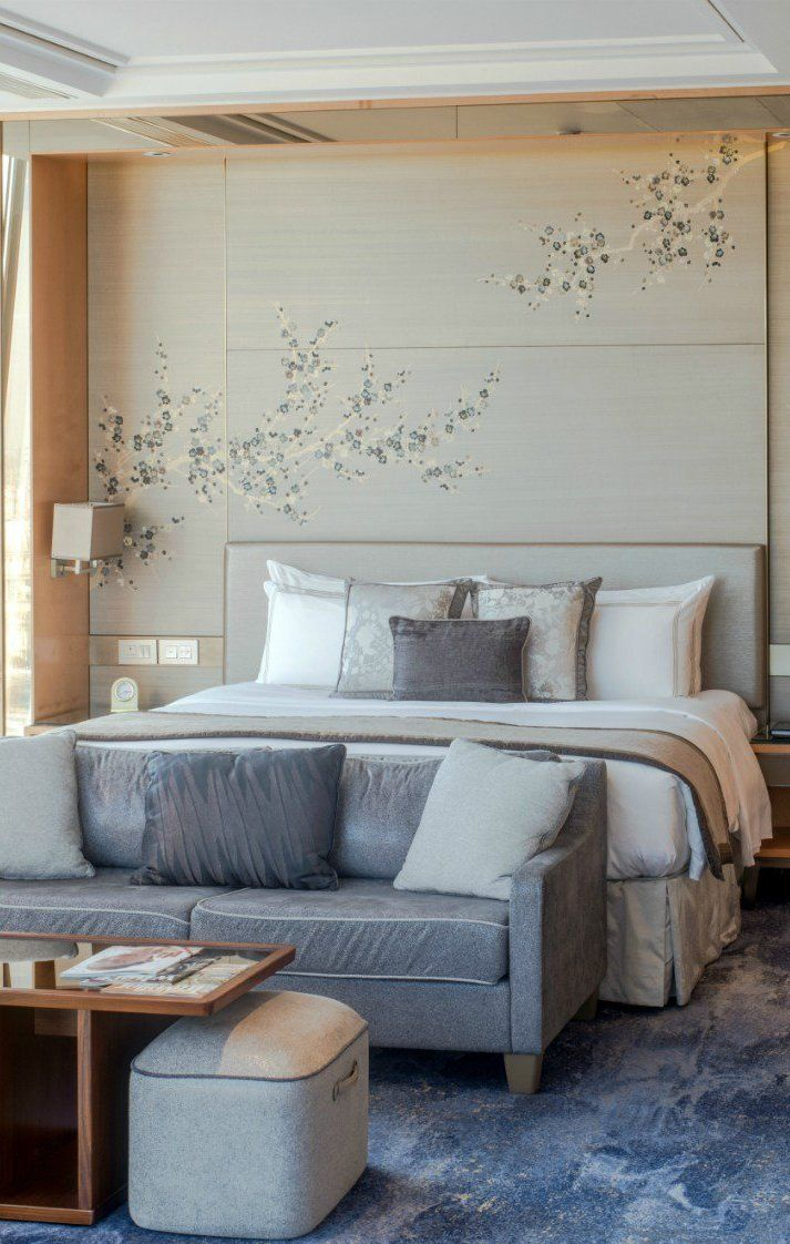 Embroidered wall-panels in sprays of Cherry Blossom decorate the wall of this bedroom in Shangri-La Hotel at the Shard, London, UK