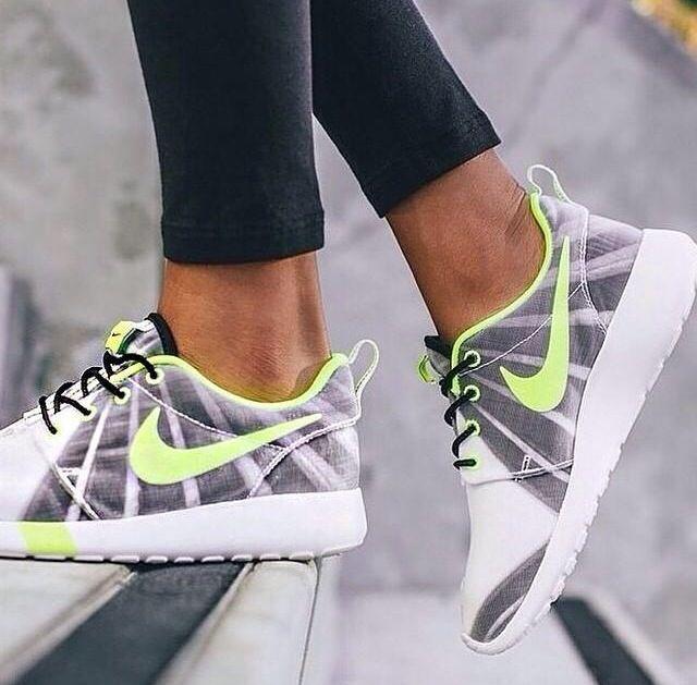 Grey, white, neon yellow Nike running shoes