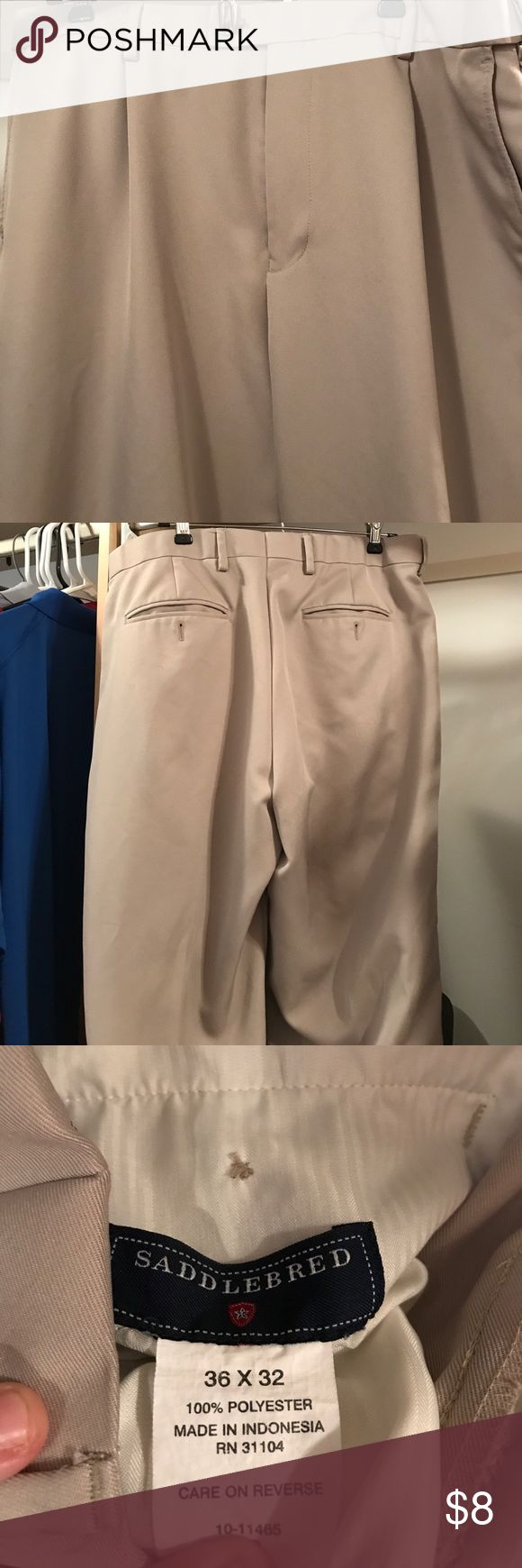Men's khaki pants Men's khaki dress pants size 36 x 32. There is a small spot on right leg front. Dry cleaning would remove it. Pants Chinos & Khakis
