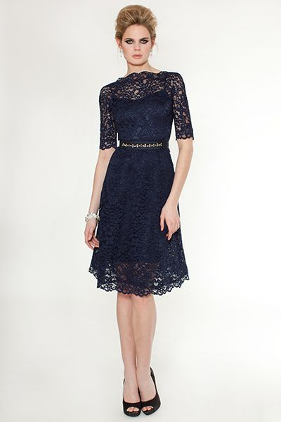 Featuring sheer elbow length sleeves and an A-line silhouette, the slim fit of this boatneck lace cocktail dress was designed to flatter and highlight your feminine figure. The A-line, fitted-all-over silhouette creates a glamorous aura reminiscent of Old Hollywood while the lace overlay and embellished belt gives it an extra sparkle to your look. ($515.00)