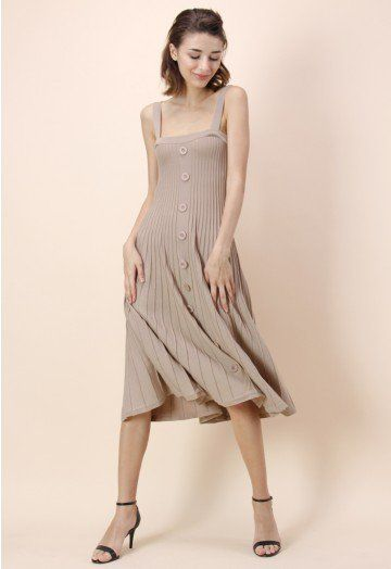 This knit dress is the ultimate go-to closet staple with its sandy nude color, button décor and stretched fabric. The modest A-line silhouette makes it a killer choice for any occasion. - Buttons decor to front - Pleated ribbed dress - Skectch knitted fabric - 100% Acrylic - Hand wash, hang flat Size(cm)  Length  Bust   Waist S            116   66-84   Free M           116   70-88   Free Size(inch) Length  Bust    Waist S           45.5…