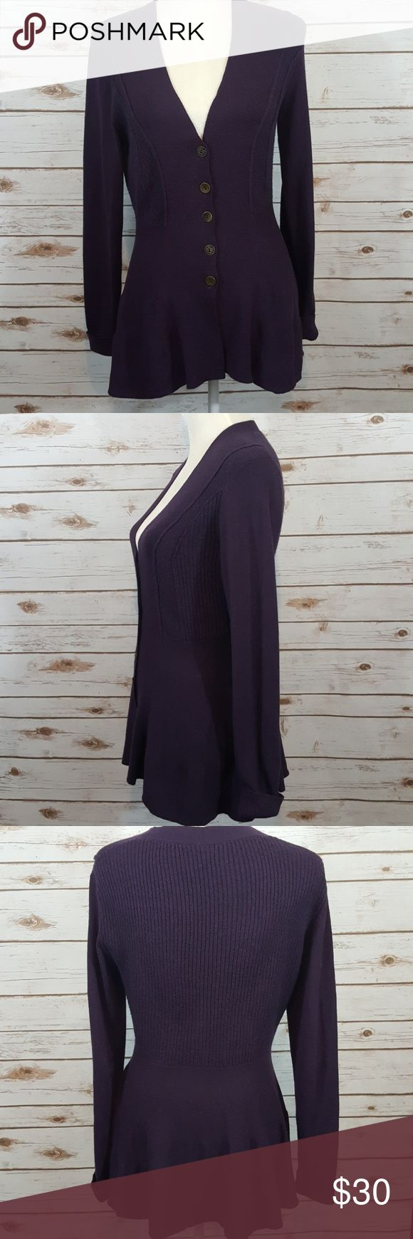 """Free people cardigan peplum hem sweater Free people cardigan sweater Beautiful eggplant color with button-front  58% cotton 22% nylon 8% wool 7% polyester 4% acrylic 1% spandex  Size tag has been cut out it is a extra small/small - please refer to measurements Flat lay armpit to armpit measures 17"""" Shoulder to hem measures 27 and 1/2 in Has peplum hem line and minimal wash wear Free People Sweaters"""
