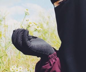 Muslimah peacefully holding flowers