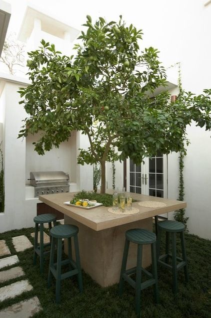 dig the fruit tree built into the table, instead of an umbrella for shade!  Just reach up and grab a snack!   mediterranean patio by Artisan of Seagrove