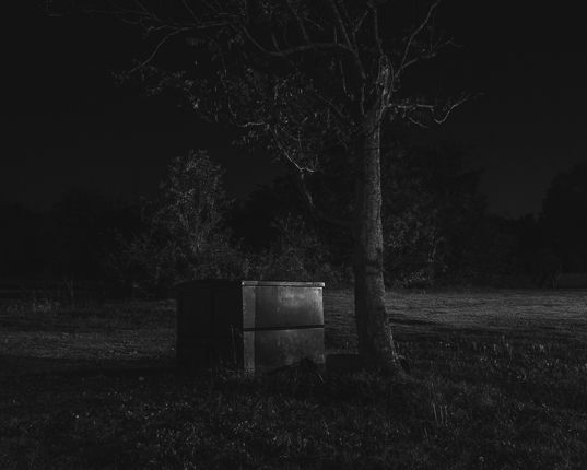 Adam Bellefeuil ----- strange objects or out of place objects. two opposing ideas (life/death?) really dark tone barely any mid/highlights
