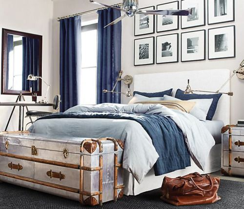 Light and airy bedroom - mix of navy blue, white and brown. Notice the navy blue curtains to keep sunlight out.
