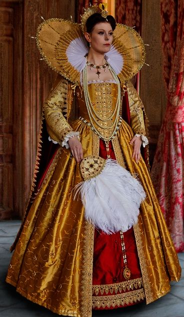 Omg Elizabethan, Tudor style royal, regal gold, red fabric, large stand up collar with pearls. Huge collar, and skirt. nice Feather fan.