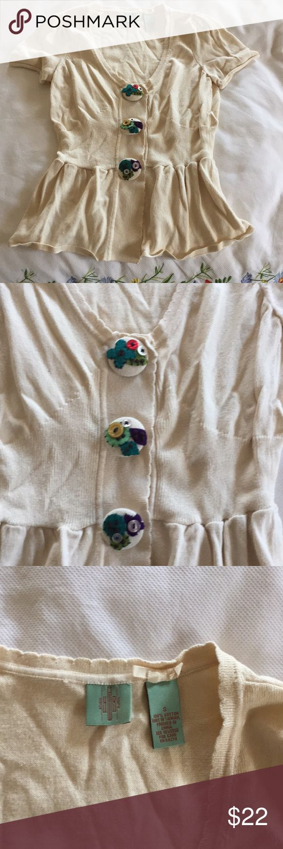 (Anthropologie) cardigan short sleeve sweater Perfect condition. Cream colored short sleeve sweater with three large embellished buttons. Fitted around the waist and flares out to a skirt look below. 100% cotton. Hand wash cold. Anthropologie Sweaters Cardigans