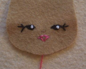 Tutorial On stitching eyes and mouth for felt dolls