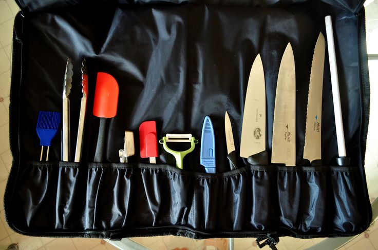 """Day 26 of Bohemea's January Photo Challenge, what's in your bag? From right to left...  12"""" Ceramic 10.5"""" MAC Superior Bread Knife 9.5"""" MAC Professional Chef's Knife 8"""" Forshner / Victorinox Chef's Knife (backup) 3"""" Henkels Paring Knife 4"""" Kuhn Rikon Utility Knife Kyocera ceramic vegetable peeler small spatula measuring spoons large spatula tongs basting brush"""