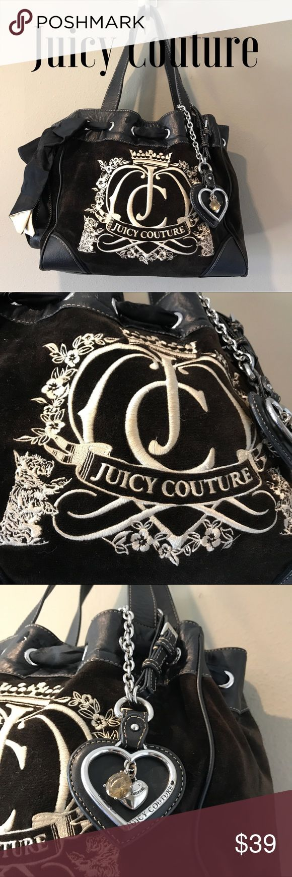 Juicy Couture Velvet/Faux Leather Tote Fabulous is the Juicy Tradition, this lovely Juicy has all the bells and Whistles.  Logo hardware, Velvet Body with faux leather trim. Some minor wearing to the handles otherwise in very good condition.  Small mirror inside is pretty scratched up but still a cute little accessory. Juicy Couture Bags Totes
