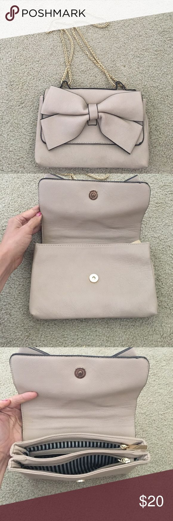 Adorable bow nude purse Gently used. Small scuff on back, noted in pictures Charming Charlie Bags Shoulder Bags