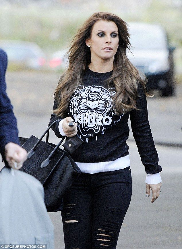 Switching things up: Coleen Rooney opted for Gothic glam on Friday as she took part in a L...