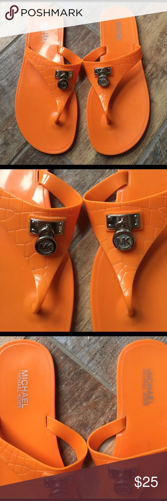 Michael Kors Sandals with Silver Logo Orange flexible plastic sandals (like a jelly shoe material) with silver hardware; worn only a couple times; good condition; great for summer! MICHAEL Michael Kors Shoes Sandals