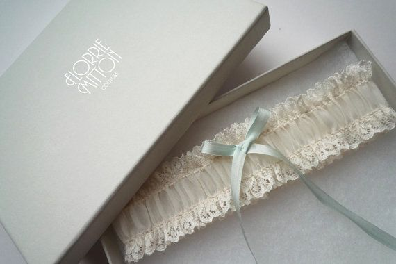 Simple but beautiful ivory lace garter with duck egg blue silk ribbon trim    Perfect for the ultra stylish bride. Each Florrie Mitton garter is