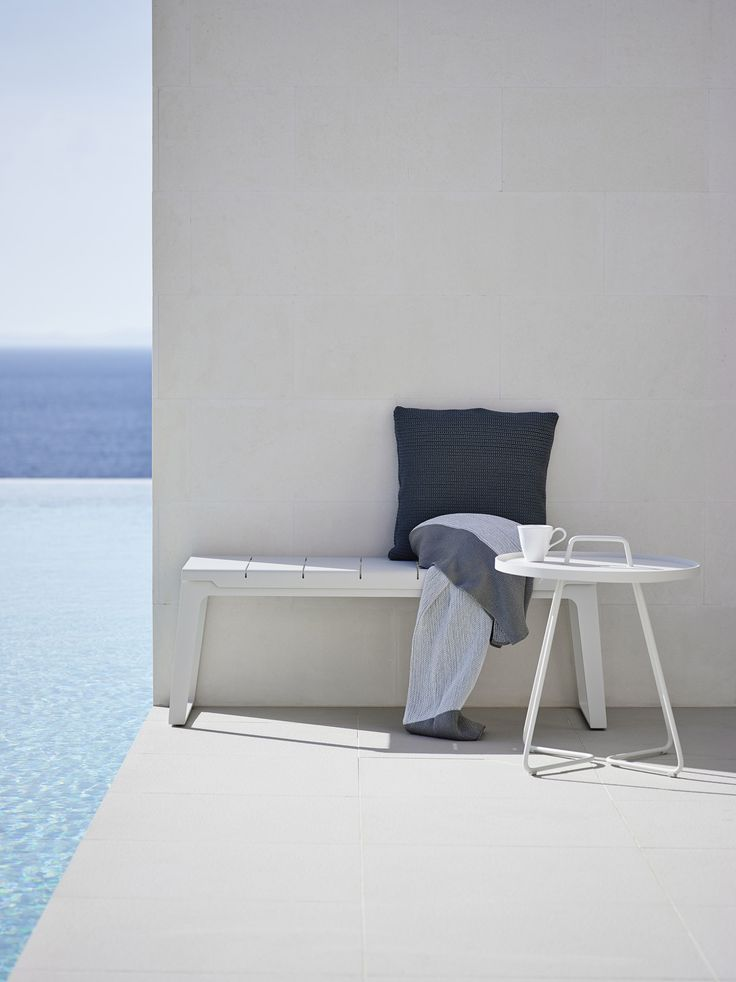 A minimalistic and highly contemporary bench made from aluminium – laser cut profiles treated with outdoor powder coat in white RAL 9002. The inspiration for this series is the urban life of Copenhagen where simple and well-designed solutions go hand-in-hand with a casual atmosphere.  #Danishdesign #caneline #strandhvass #outdoor