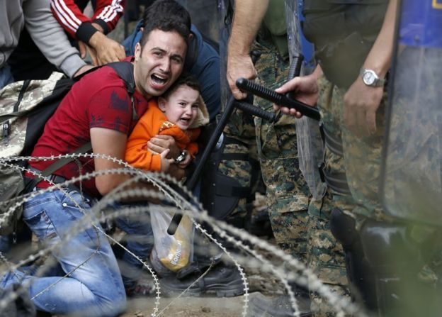 When Macedonia closed its border to migrants last month, after declaring a state of emergency, thousands spent a night in no-man's-land. The following morning they tried to push through police lines, leading officers to fire stun grenades into the crowd. AP photographer Darko Vojinovic captured this young father's despair. In the previous three weeks 39,000 migrants had been registered as they passed through the country en route for Serbia, and then Hungary - a member of the European Union.