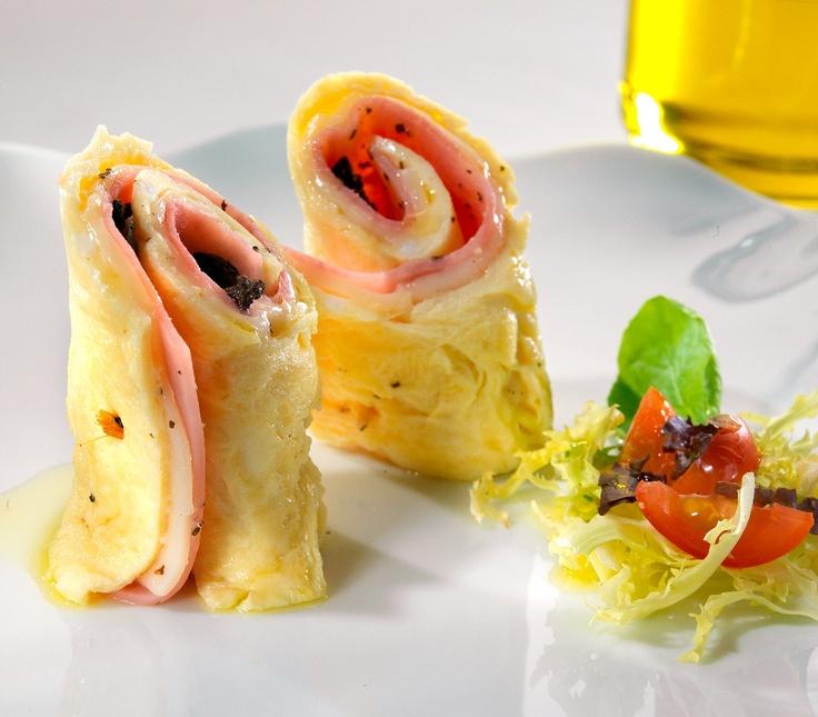 Desayuno Empresario: Wrap de Jamón, queso y Rùgula, Pandebono, Jugo Natural y Bebida Caliente.