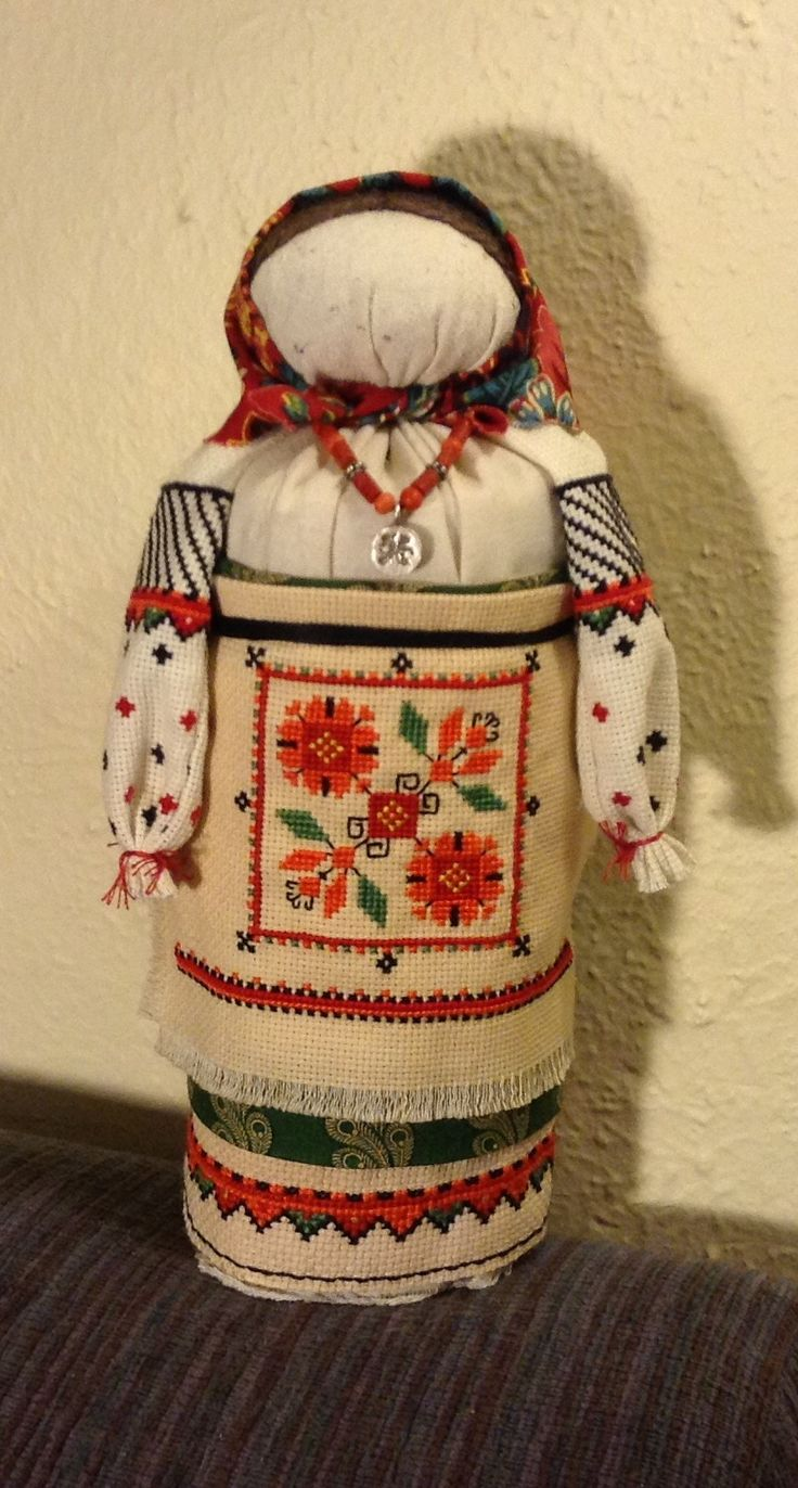 I made this Ukrainian Motanka doll for my lovely sister Halyna! The clothing is hand-embroidered and the little necklace is made with natural coral and sterling silver. This was so much fun to make!
