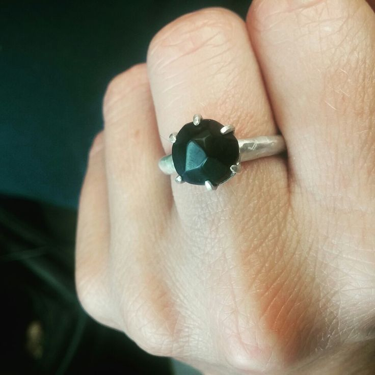Soft faceted ring. Onyx from Sardinia, silver.