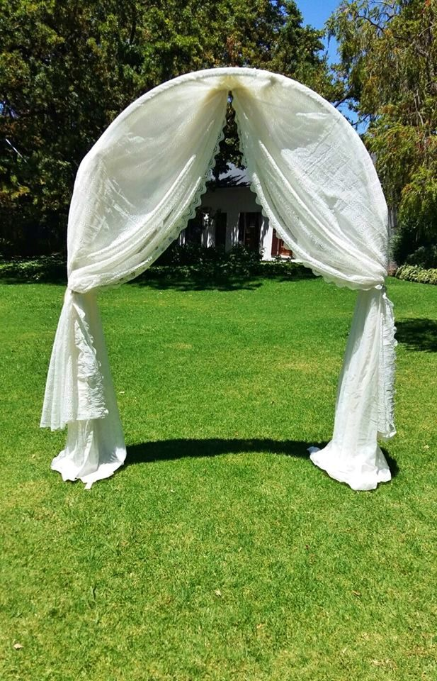Rustic, vintage wedding. Roses, Baby's breath. Lace draping, vintage wedding arch. Event planner | Wedding planner | Florist | Floral designer | Cape Town
