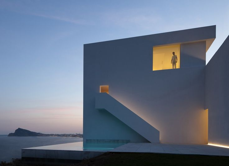 This bright-white house in Alicante by Spanish studio Fran Silvestre Arquitectos features an 18-metre-long balcony that stretches out towards the Balearic Sea #Architecture