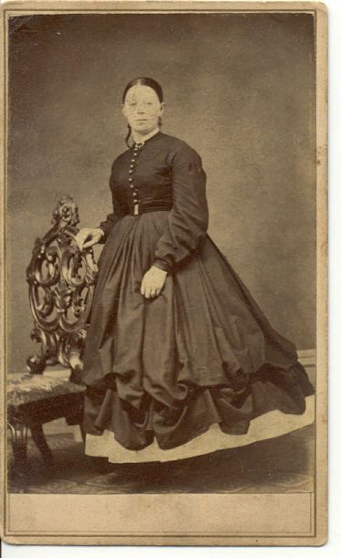 CDV showing lifted skirt, an oddity in this era. Ruching like this won't be seen in fashion plates until the 1880's, bustle era. This photo is 1860's