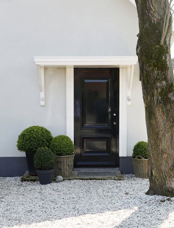 Boxwood planters curb appeal black front door ; Gardenista