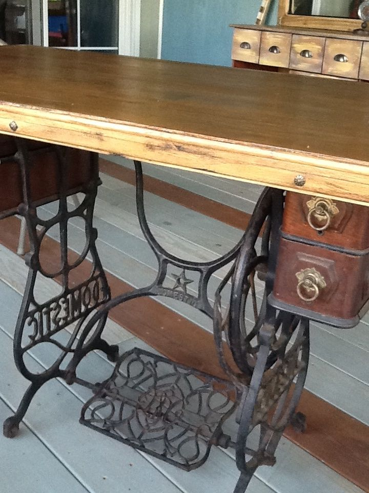 Close up.  Sewing machine was a garage sale find.  Top was damaged and in poor condition.  The date on the base is 1887, the top is salvaged wood.  Dumpster dived the oak wood and reused leftover hardwood flooring for the table top.  Sanded, painted, antiqued' the top before adding a oak varnish.