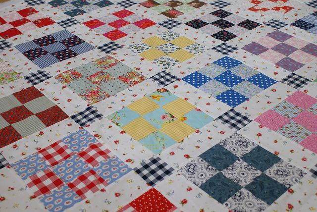 Scrappy nine patch, love!   nine patch quilt by dutch blue, via Flickr