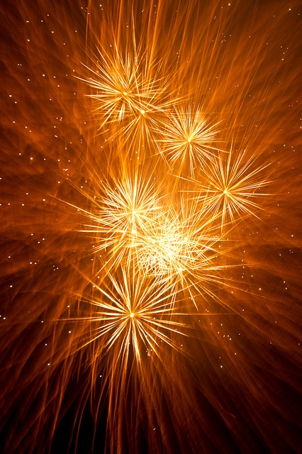 Golden fireworks illuminate the sky, bright but pleasant way up high, crowds cheer looking up at you...Golden fireworks never blue.