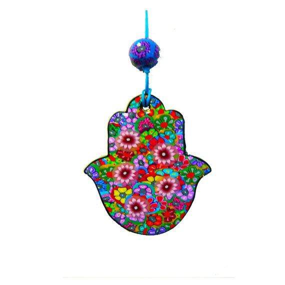 Home decor Hamsa, Hamsa wall hanging, Hamsa wall decor, Hamsa hand, evil eye, Hamsa decoration, Hamsa decor, Hamsa wall art. Jewish gifts  This lovely Hamsa will be a wonderful gift for a new home or new business, for a wedding, for Bat Mitzvah or for any occasion. You can hang this lovely Hamsa at the enter of your house for protection and good luck This colorful Hamsa is hand made all the flowers I sculpted by my hands with the Millefiori technique its pass oven backing and I put a special…