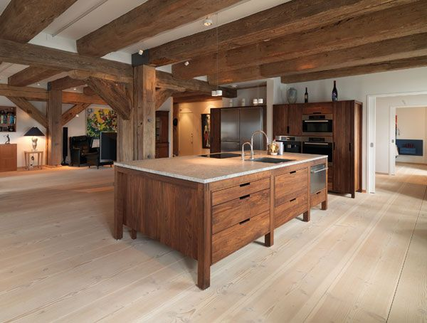 American Walnut Kitchen, Copenhagen l Warehouse with luxury apartments | Architecture at Stylepark  Pale cork floor, walnut cabinets white ouster top and walls
