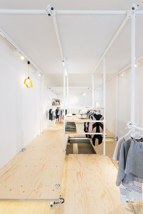 Scaffolding forms temporary clothes rails at Berlin pop-up shop by Kontent | Architect Lover