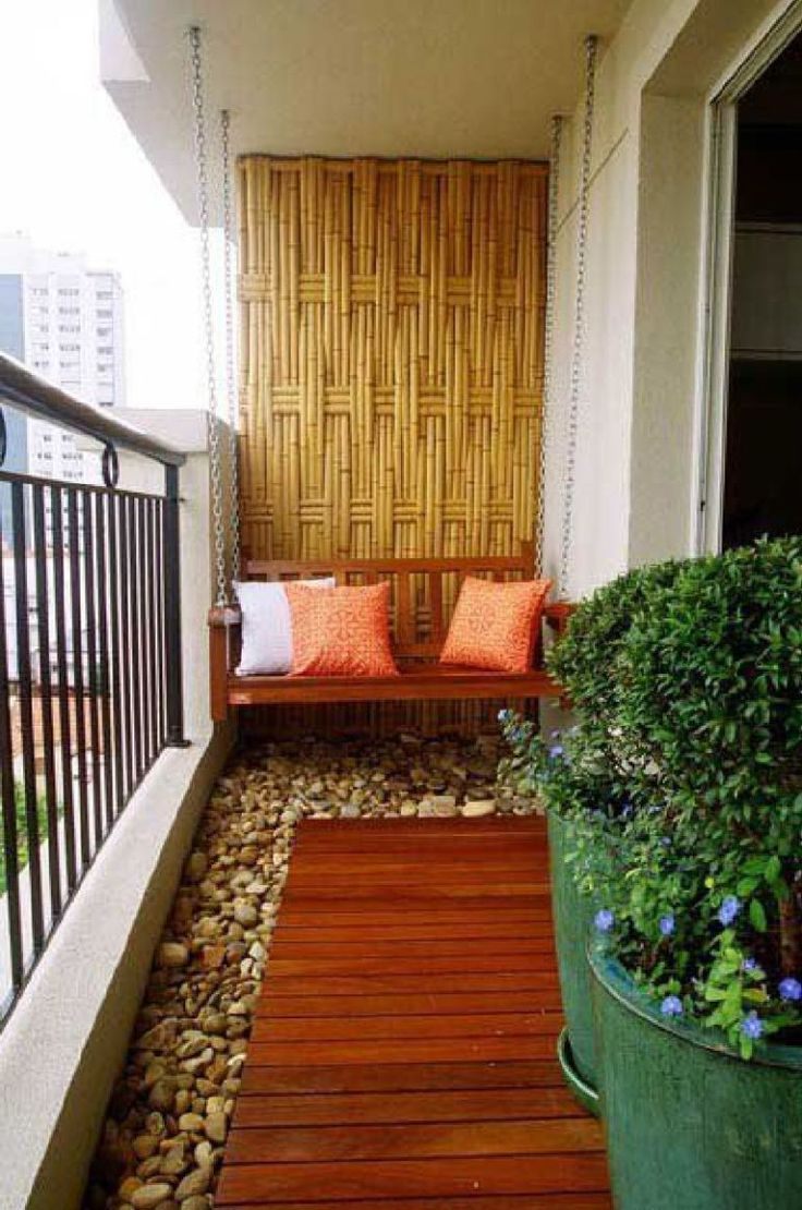 Small apartment patio decor - Japanese Inspired Balcony Design Featuring River Rocks A Swing And Bamboo Wall Decor Along Beautiful Apartment Balconiesapartment Patiossmall