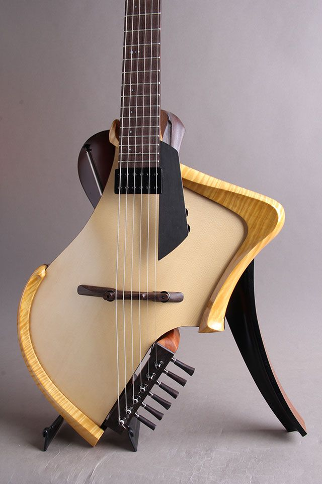 Michihiro Matsuda Guitars | Matsuda headless arched top acoustic electric guitar – Michi also built an experimental ukele in the same manner known as the Deconstructed Uke. Worth a look if you enjoy wayward departures from the norm! :-)