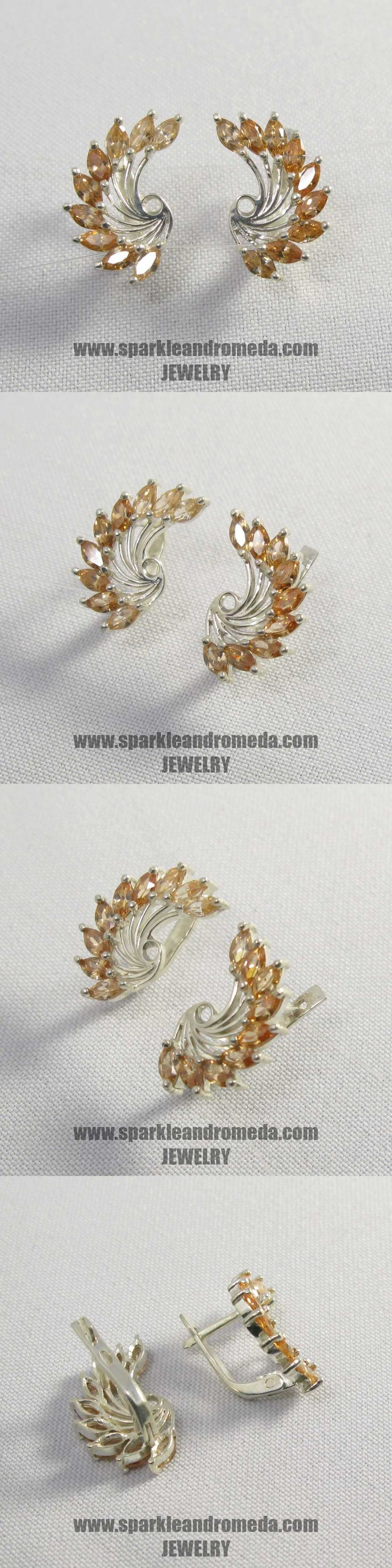 Sterling 925 silver earrings with 18 marquise 5×2,5 mm champagne diamond color cubic zirconia gemstones.