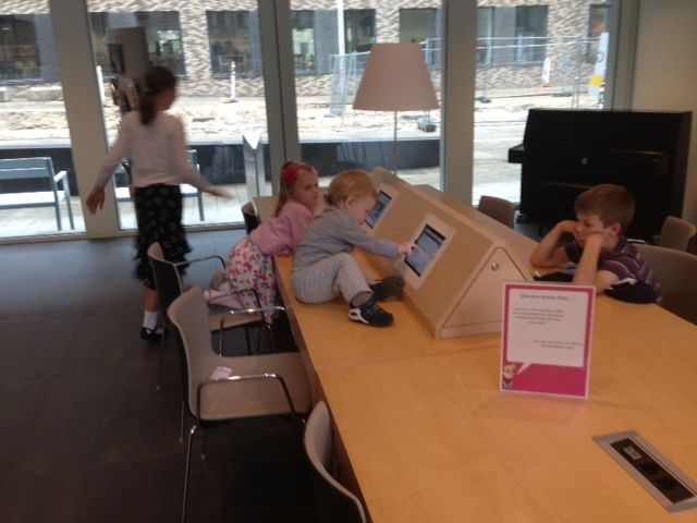 Our youngest ambassadors are playing on the iPads in the hotel lobby!