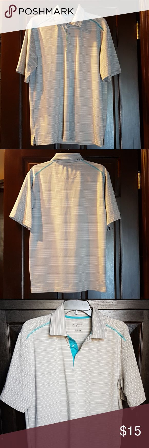 💥SALE TODAY ONLY💥Men's Polo Golf Shirt Tommy Armour Dri-Logic brand polo shirt  Gray stripes with a nice Aqua Blue stitching and accent around the collar. Comes with an spare button *see pic  Very comfortable. Good condition.   Signs of slight wear on the right bottom (see pic) Tommy Armour Shirts Polos