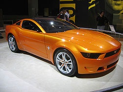 Giugiaro Mustang concept In 2005, Fabrizio Giugiaro, styling director of Italdesign Giugiaro, went to the Ford Motor Company to design a future concept inspired by the fifth generation Ford Mustang. This follows the pattern of Giorgetto Giugiaro, who was instrumental in designing the 1965 Bertone Mustang, .... interpretation of European styling on the 2005 version of the American pony car.