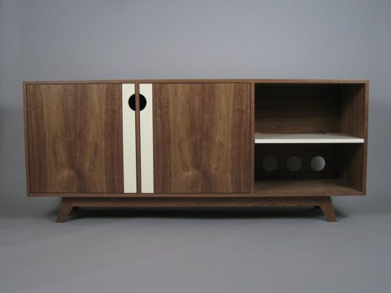 All the amenities of a modern media cabinet - ventilation, cable management, soft closing hinges - while maintaining a mid-century feel.