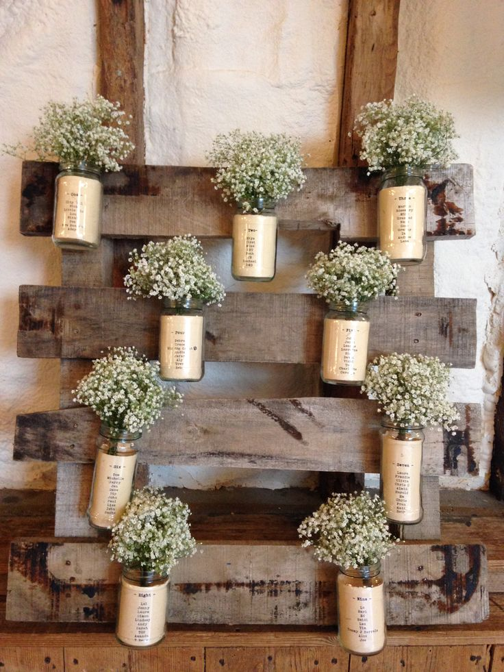 Quirky table plan idea using jam jars, Gypsophila and an old pallet!