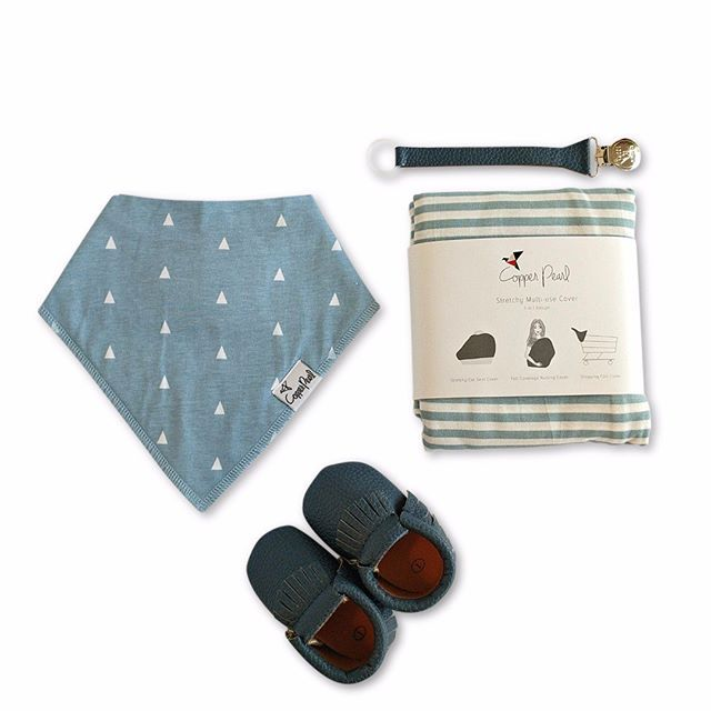 """Here it is in a flat lay: """"Little Boy Blue"""" is a sweet, classy set. It includes: -dusky blue baby moccs by Sweet N Swag -Dusky blue paci clip by Sweet N Swag -coordinating blue cotton bandana bib by Copper Pearl -blue striped stretchy Multi-use Cover by Copper Pearl  #luxbabybox #newmomgift #babyshowergift #bestbabygift #curatedgiftbox #babygiftbox #copperpearl #sweetnswag #babymoccs #bestbabypresent #blueisforboys#paciflip #babydroolbib #leatherpacifierclip #babyflatlay"""