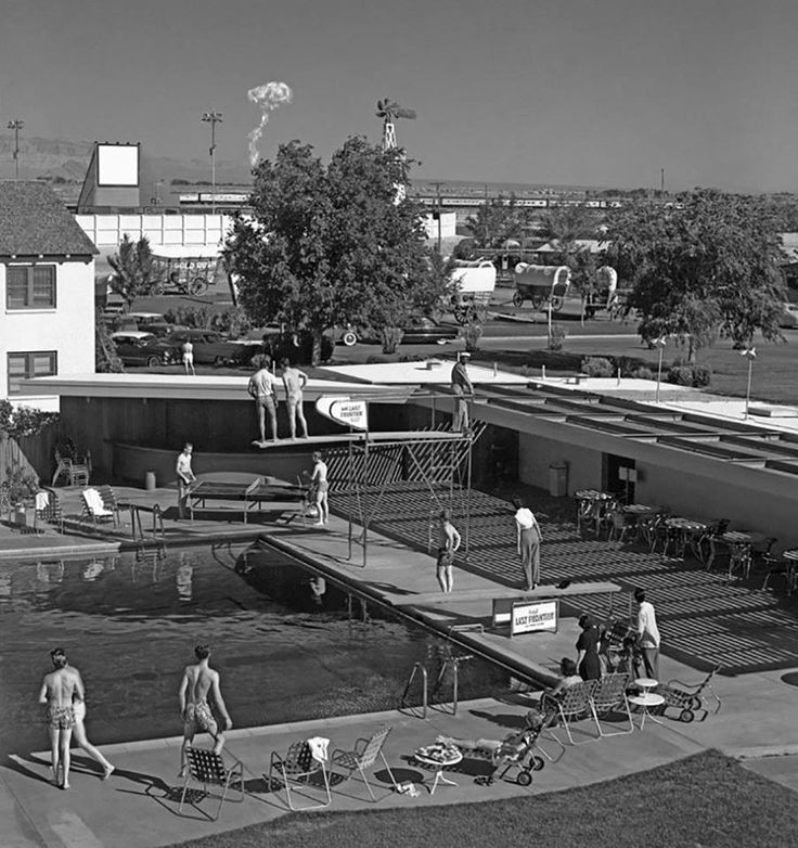 Morning swimmers in Las Vegas watching a mushroom cloud from an atomic bomb test 75 miles away, 1953
