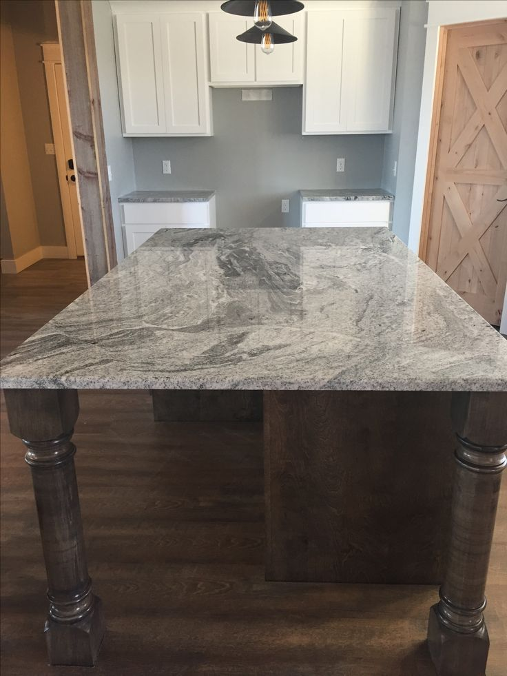 White Viscon Granite On Birch Stained Island In New Ebony