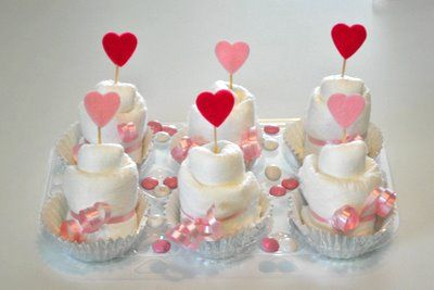 diaper cupcakes... now this is different and super fun! instructions included!