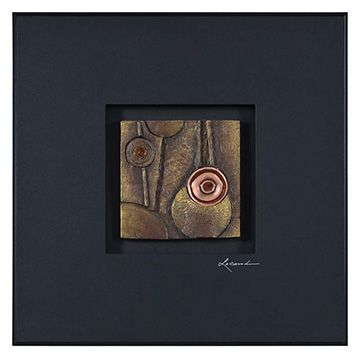 A tribal earth-tone design is painted on stone and set in a recessed dark background. Finished with a delicate black frame.