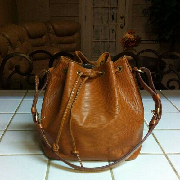 Louis Vuitton bucket bag Authentic true vintage Louis Vuitton bucket bag. In great condition for being vintage some wear on corners and button but you can use leather pain to pain it and make it look new. What you see in the picture for being vintage. Offer should go through offer feature. Color is burnt orange. Louis Vuitton Bags Shoulder Bags