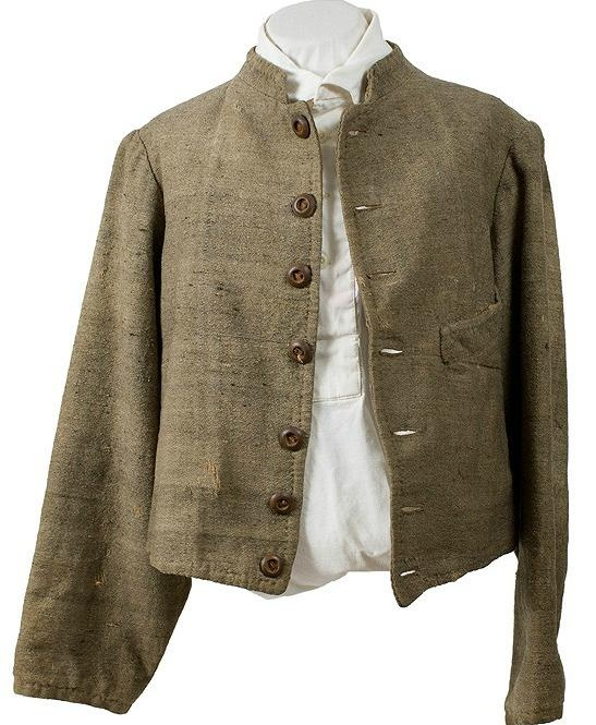This Confederate lined shell jacket has seven wood buttons, is butternut in color, and has an outside pocket on the left side and an inside pocket on the right side.    The jacket belonged to George Jacob Mook, Company D, 4th Missouri Cavalry CSA. Mook, a resident of St. Louis County, joined the regiment in June 1863 at Bird's Point, Arkansas.